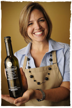 Natalie Jaeger and a bottle of Extra Virgin Olive Oil